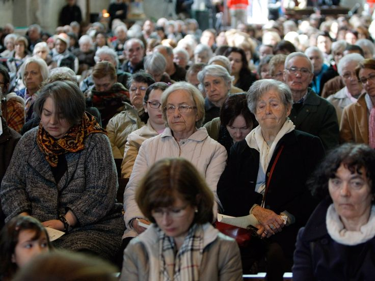 People attend the special Mass to honor the victims of the Germanwings jet crash, inside the cathedral Notre Dame de Bourg, in Digne-les-Bains, France on March 28.  Claude Paris, AP