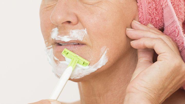 What cause facial hair growth in women
