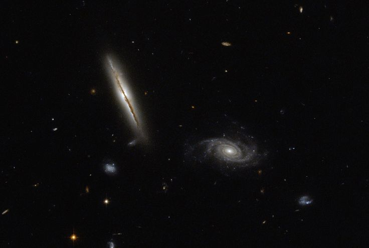 Hubble Space Telescope image of spiral galaxies LO95 0313-192 (left) and [LOY200…