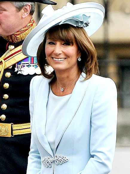 CAROLE MIDDLETON The mother of the bride adds something blue in her sky blue silk dress and matching passementerie coat by Catherine Walker (one of Princess Diana's favorites), paired with a matching hat by Berkshire based milliner Jane Corbett.