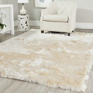 Shop for Safavieh Handmade Silken Glam Paris Shag Ivory Polyester Area Rug (5' x 8'). Get free shipping at Overstock.com - Your Online Home Decor Outlet Store! Get 5% in rewards with Club O!