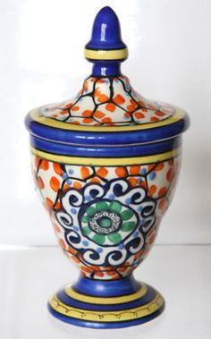 This is a matching pair of hand-painted Art Deco Pottery vases ...