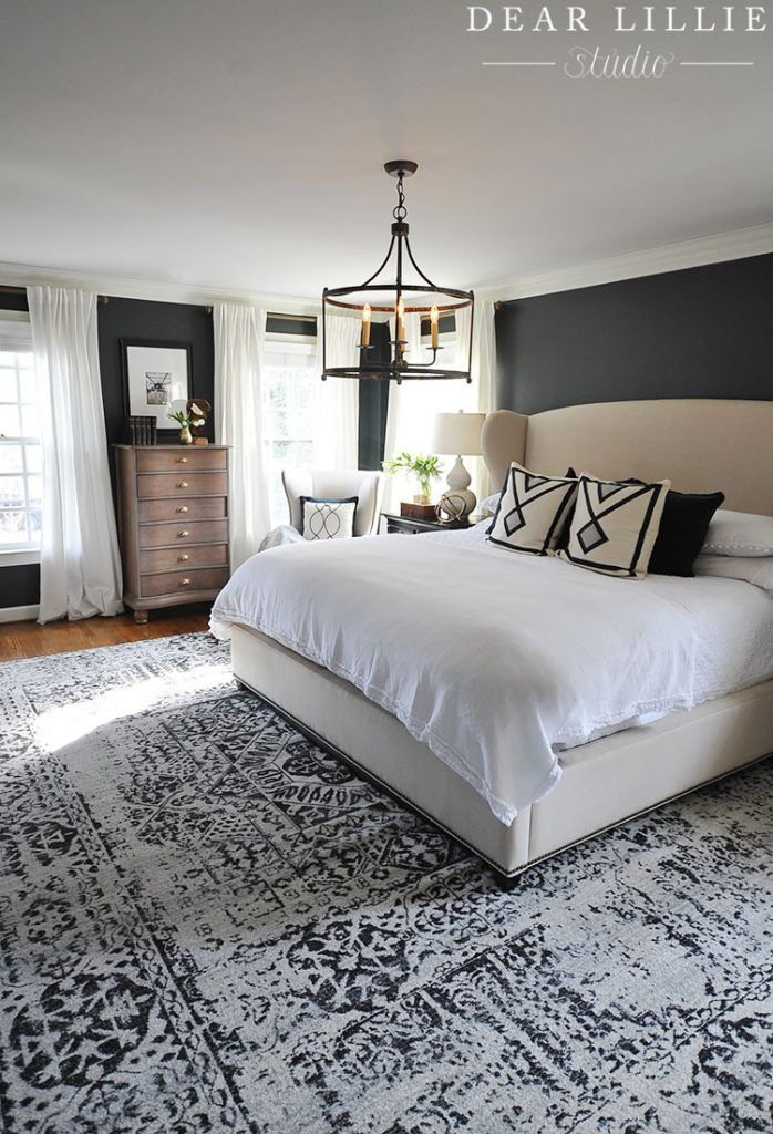 Today I wanted to share the finishing touches that we added to our master bedroom, including a new rug and artwork. I moved a small rug up shortly after we moved in. It was a rug that I loved but it was way too small for the space so we layered other rugs on top of it.