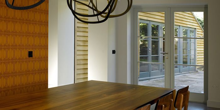 Contemporary wooden french doors in a modern property