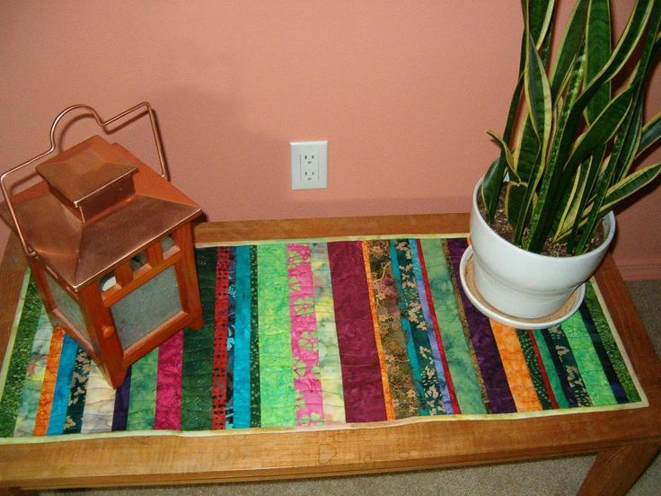 #FreeQuiltingPattern - Scrappy Quilt-as-you-go Table Runner - perfect for using up that extra fabric and adding some color to your home! Download the pattern instantly for FREE!