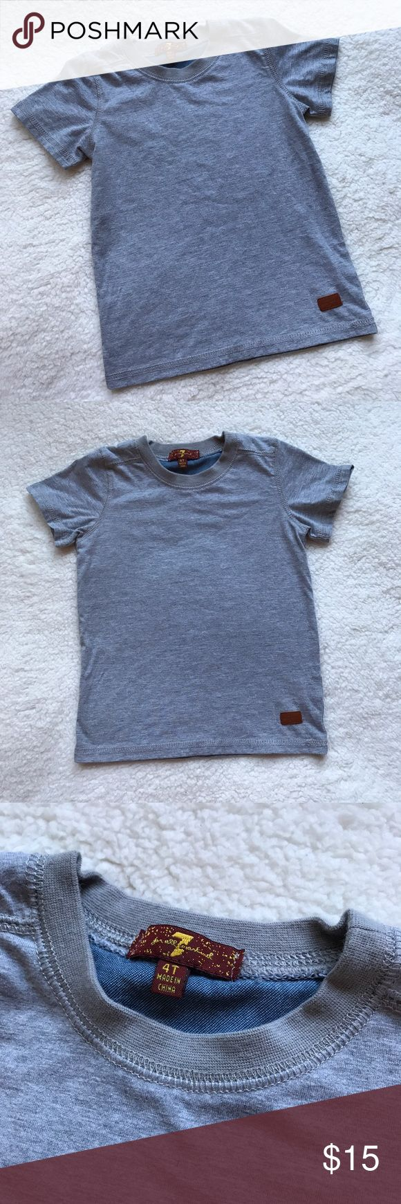7 for all Mankind Gray Fitted Crew Tee Shirt 7famk ✨ Reasonable offers welcome ✨  Boys 7 for all Mankind Gray Short Sleeve Tee Shirt  Great condition! Worn once! Heather Gray Color!   Labeled a size 4, but there is no way. It fit my youngest when he was 2. So putting the size as 2T.  Bundle & Save!! 7 For All Mankind Shirts & Tops Tees - Short Sleeve