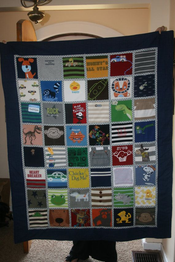 Quilt made from old onesies. This kinda seems wasteful because someone else could be using these barely-worn baby clothes. But this could be cute for the worn-out favorites.