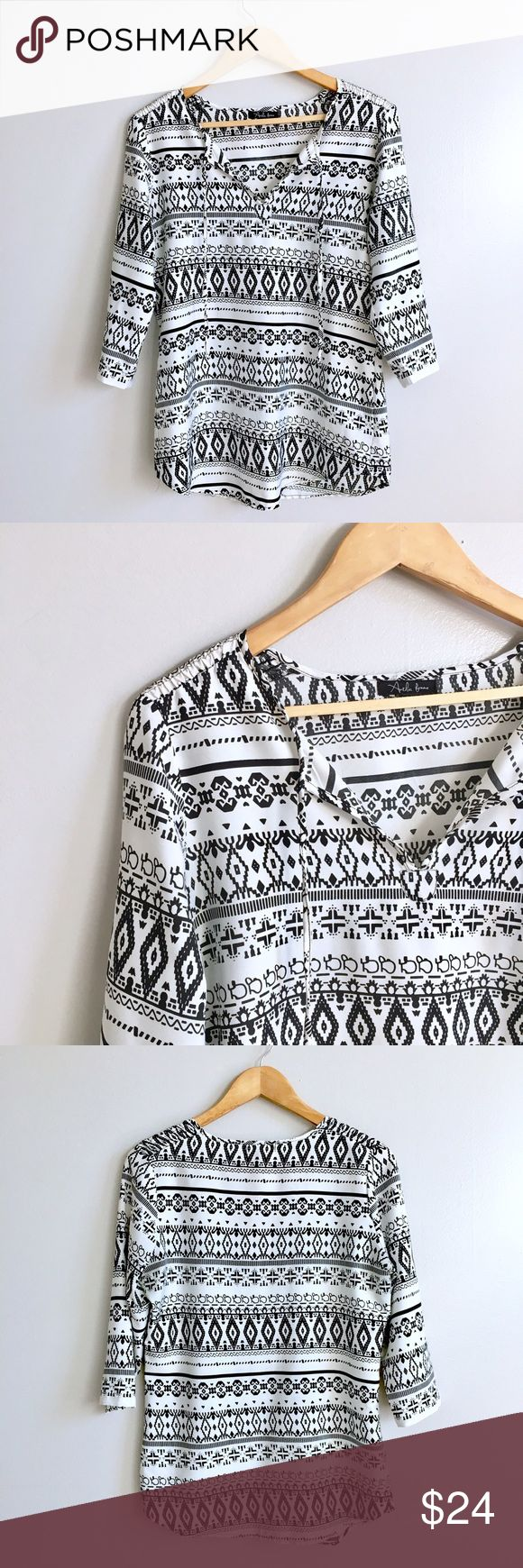 Aztec Blouse Black and white print blouse. Three quarter sleeve. V-neck with ties. Excellent condition. Acids the chest 20 inches. Shoulder to hem 29 inches. Small but can fit medium. Check measurements. Urban Outfitters Tops Blouses