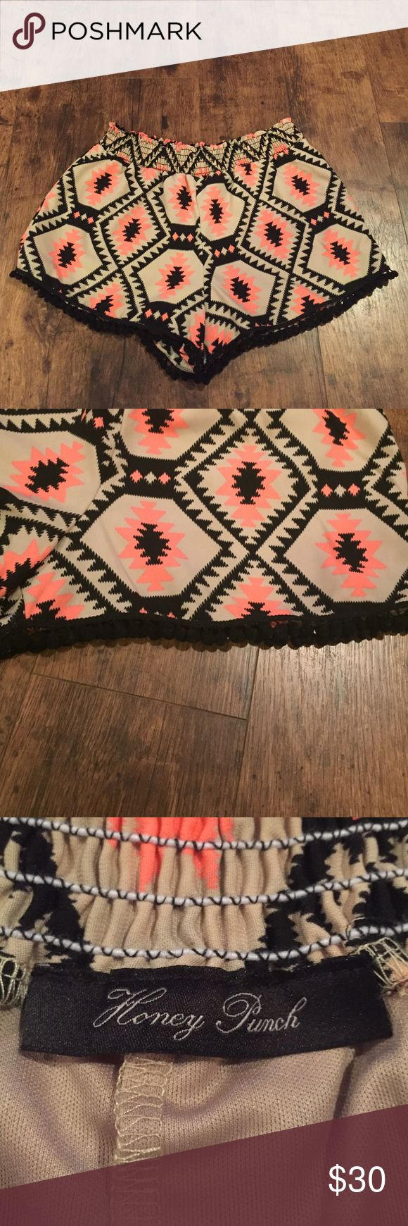 Honey Punch Pom-Pom Tribal shorts Honey Punch pom-pom trimmed tribal shorts in beige, neon coral, and black. Cute shorts for any occasion! Elastic waistband! Great condition, offers welcome! Honey Punch Shorts
