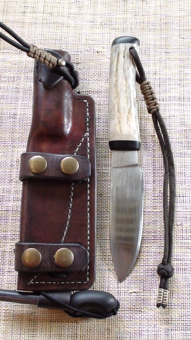 Bush Craft Sheath for hand forged camp knife. Antler handle & buffalo horn guard. Has dangler loop, vertical & horizontal carry options, molle compatible, fire steel loop, shock cord retention strap and lanyard. Vegetable tanned calf shoulder leather, hand stitched.