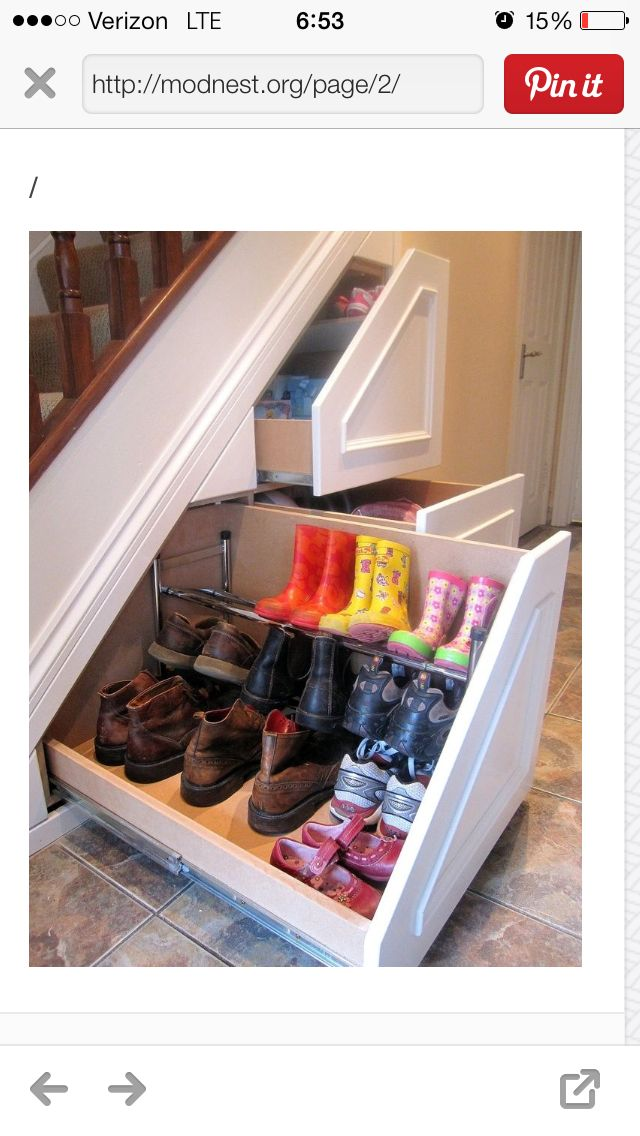 Pull out shoe tray under the staircase...brilliant!