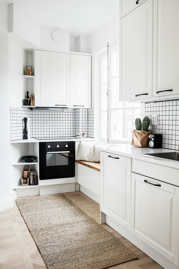 Cleverly designed small neutral kitchen with a liitle seating nook