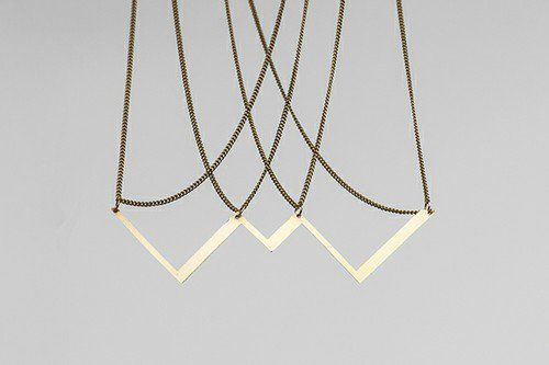 The absolute value function can be traced on the necklace. This piece of jewellery would look great on a top or in a cleavage.  #jewelry #design #geometry #maths #minimal #contemporary #serajewellery #brass