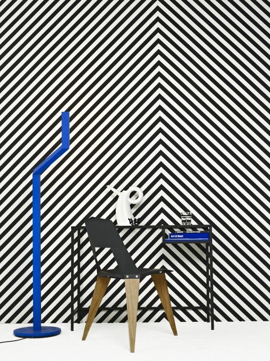 This room has geometric form because there are stripes on the wall. Also because the chair is made up of squares, and rectangles.