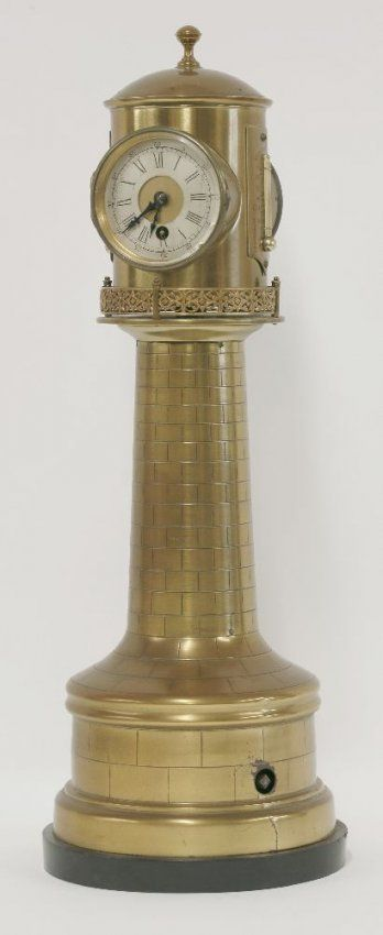 A Victorian brass English lighthouse clock, the revolving top with clock, barometer and two thermometers on a tapering column, the base with clockwork mechanism,