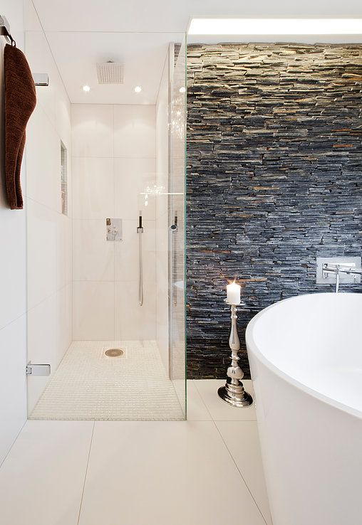 Close collaboration between architect and tiler. Focus on ambitious and unique bathrooms. All work shown is built by us.