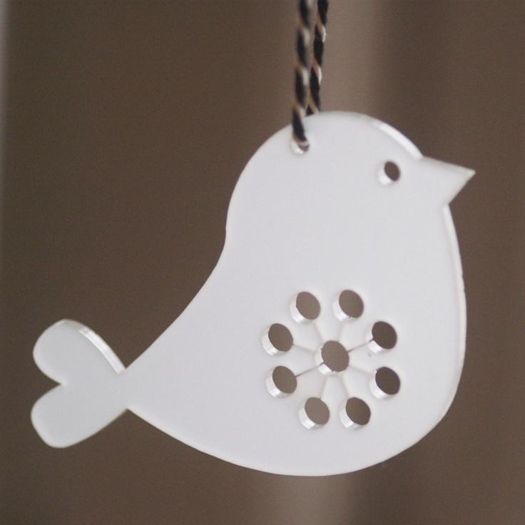 Birds in white transparent lasercut plexiglas