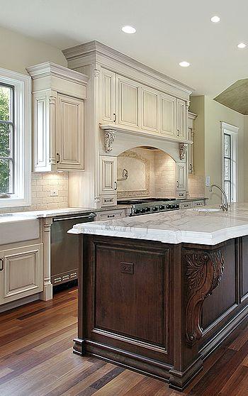 Classic kitchen design ideas. Antique white kitchen with dark stained wood island.