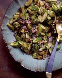 Roasted Brussels Sprouts with Capers, Walnuts and Anchovies | The key to Michael Symon's deeply savory side dish is a dressing that includes anchovies, capers, mustard and a little honey.