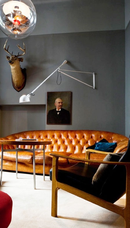 tan leather chesterfield and grey walls - love this color combo