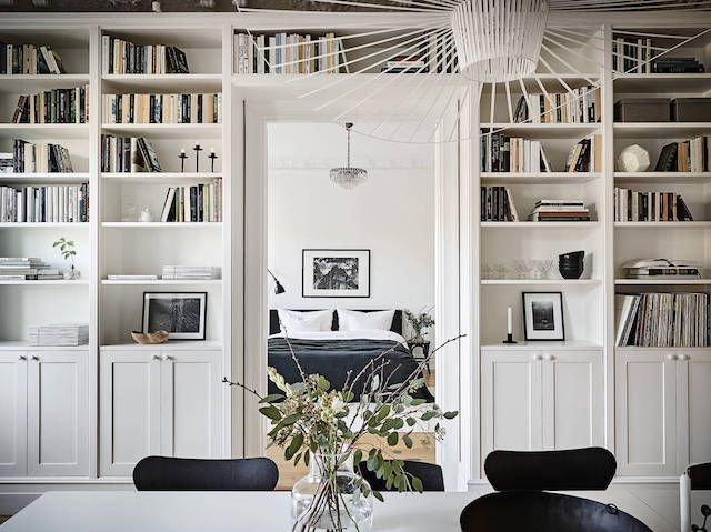 Built-in book shelves in a stunning Swedish space in white - stadshem