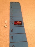 Park Your Car Dice game: Make a large parking lot with the numerals 2-12. Give students two dice and a play car. Students roll the dice, add the numbers, and park their car on the answer