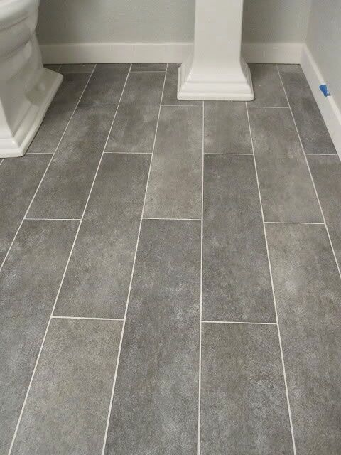 """gray plank ceramic tiles - very similar to new kitchen floor except there's a little more variety in the """"grain"""" look to ours; using dark gray grout...can't wait until it's all done!"""
