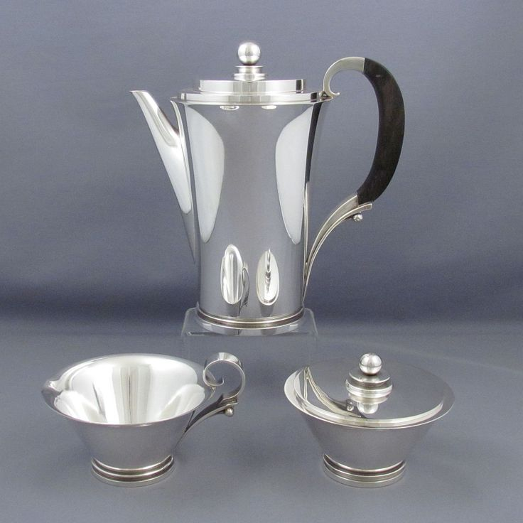 A beautiful three-piece Art Deco style sterling silver coffee set by Georg Jensen, made in Copenhagen 1945-51. Pyramid pattern sterling silver coffee set