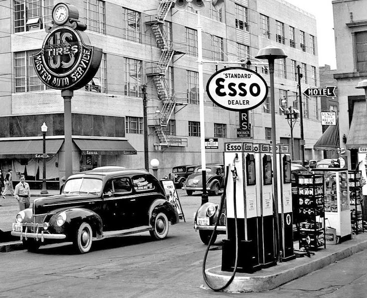 1940 Ford at a Vintage Esso Gas Station Selling US Tires