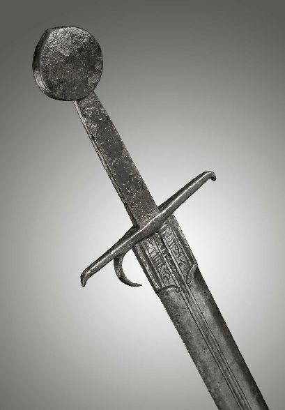 """Am Italian Medieval sword with an Arabic inscription from the arsenal of """"ALEXANDRIA"""", early 15th century dated 1453 A.D."""