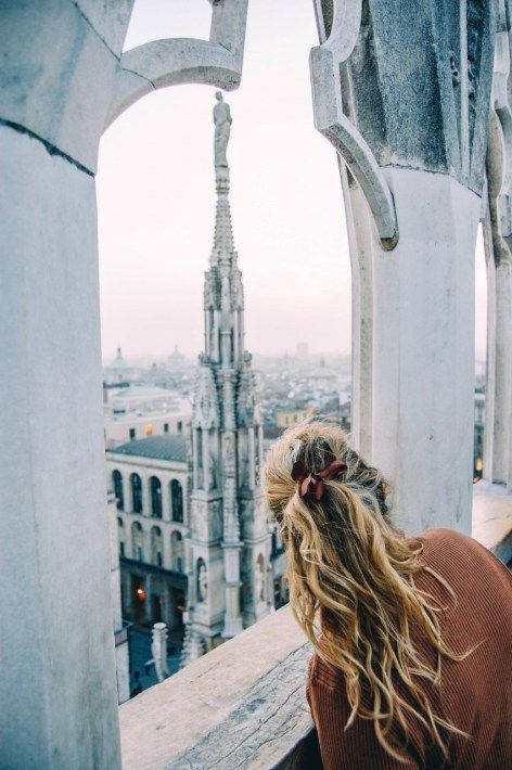 View from the Duomo in Milan. How to Avoid Lines and People When Traveling - Helene in Between