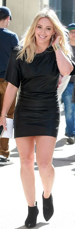 Who made  Hillary Duff's black boots, leather dress, and gold jewelry?