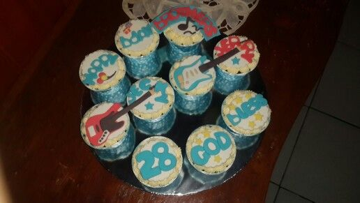Guitar and bass themed bday cupcakes for twin bros...