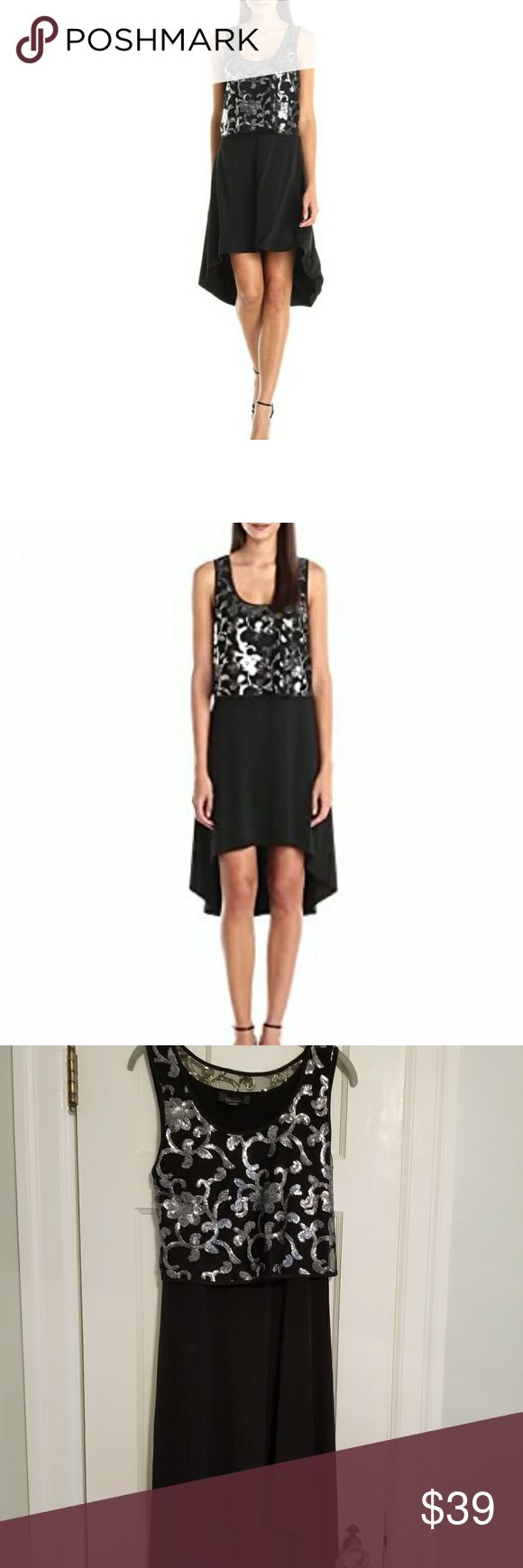 Karen Kane High/Lo Dress w Sequin Top Karen Kane Boho Blush Black Jersey Hi-Lo Dress with Silver Sequin Top.     Size: L      New without tags   92% Polyester, 8% Spandex Made in the USA or Imported Dry Clean Only Scoop neck Sleeveless Karen Kane Dresses High Low