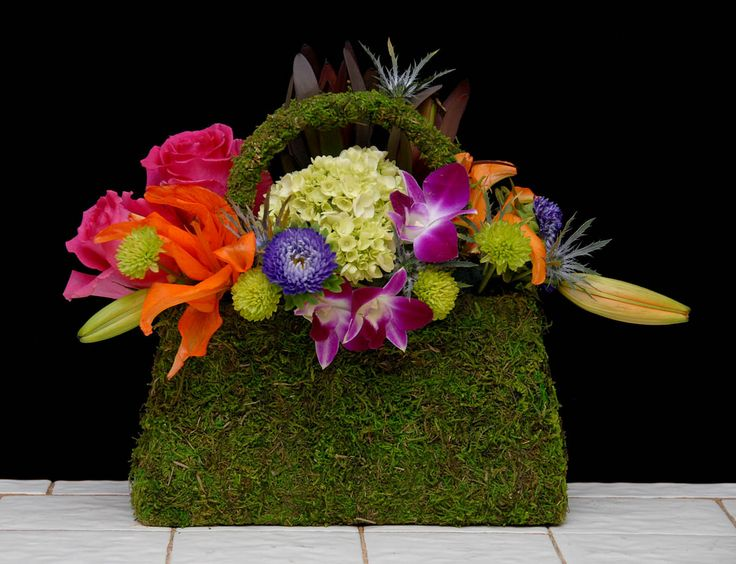 https://flic.kr/p/xuZ5Qp | Tropical Purse — The Rittners School of Floral Design, Boston | Floral designers today are incorporating fashion accessories, such as shoes and purses, into their floral art. These are things you can order from your local florist. They work very well for parties, showers, celebrating an accomplishment, milestones, birthdays, ladies luncheons and brunches and more.  — Photo Courtesy The Rittners School of Floral Design, Boston, www.floralschool.com/