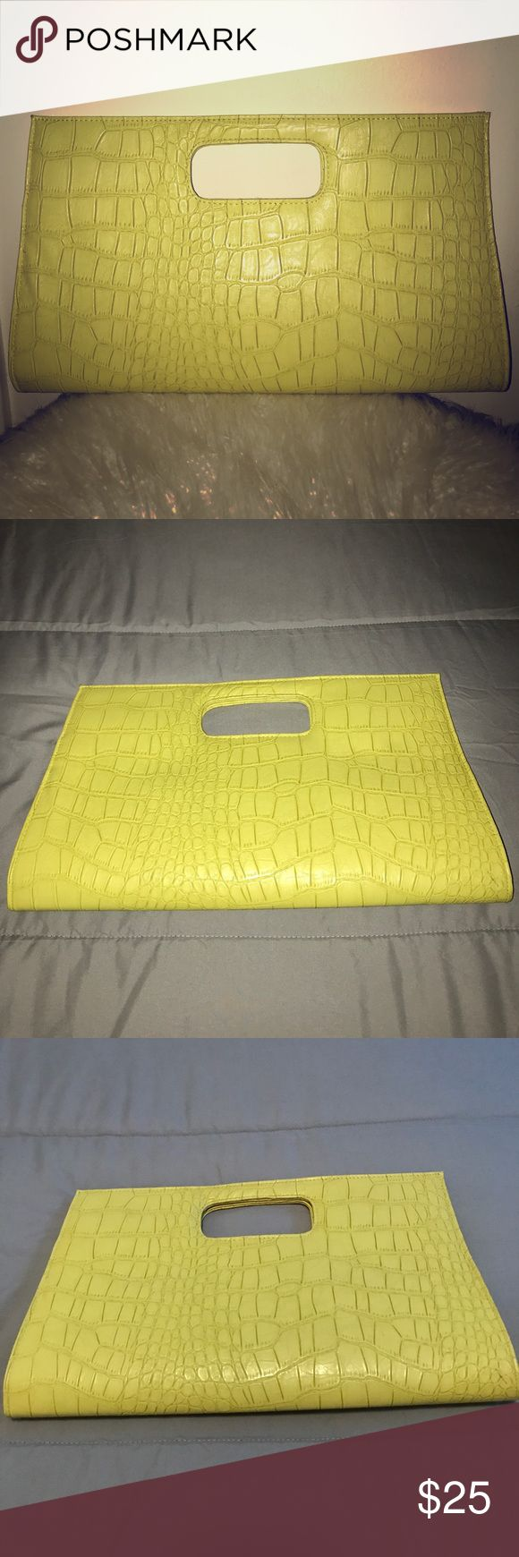 Yellow clutch All yellow oversized clutch purse! No chain, no straps, clutch purse only! Beautiful bag with turquoise interior! Bags Clutches & Wristlets