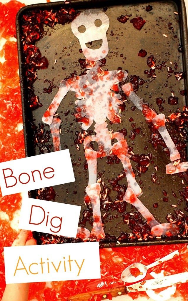 """Fun Halloween Activity- Dig out """"bones"""" from """"blood!""""  Great Halloween, science, and sensory activity all rolled up in one!  #Halloween #creativepreschoolers"""