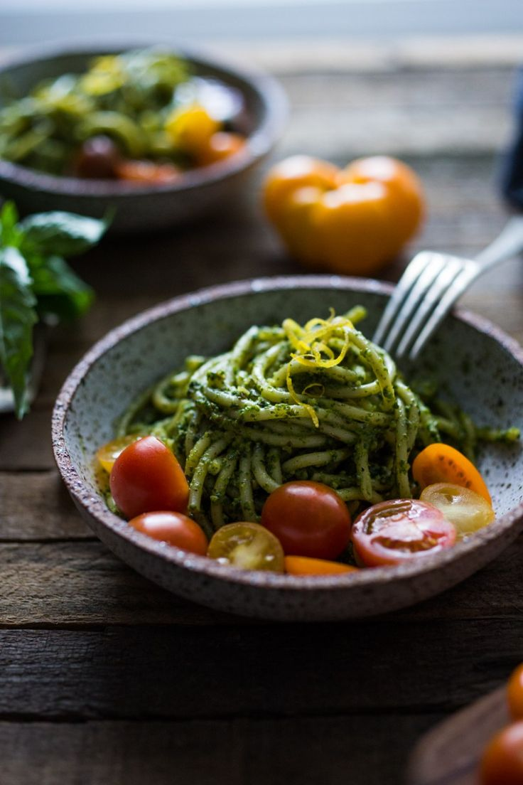 Bucatini Pasta with Arugula Almond Pesto and mini heirloom tomatoes. Vegan, VERY flavorful and FAST! | www.feastingathome.com