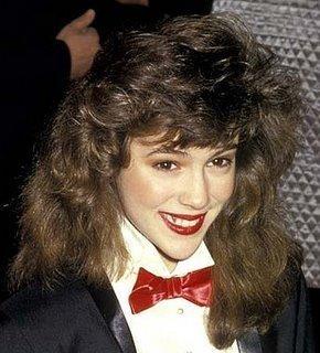 Soap opera actress Alyssa Milano with crazy hari and red bow tie - #80s