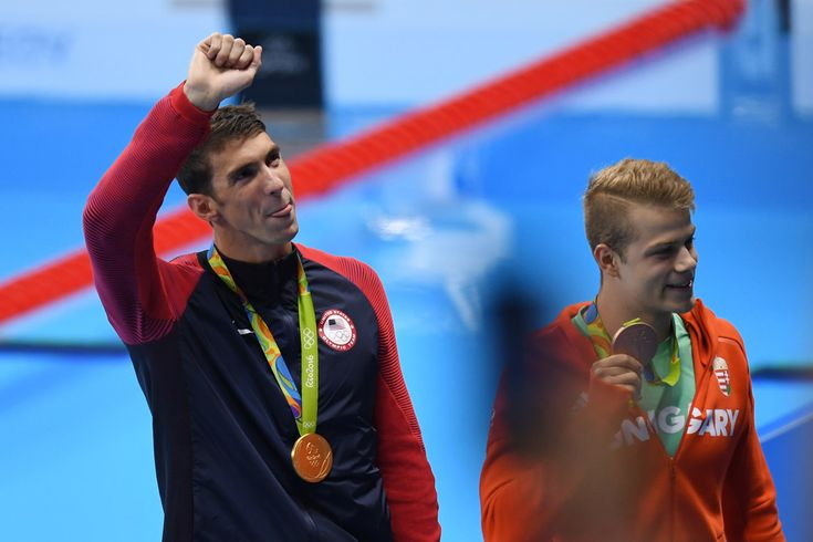 Gold medalist Michael Phelps of the United States celebrates during the medal presentation for the Men's 4 x 200m Freestyle Relay Final on Day 4 of the Rio 2016 Olympic Games at the Olympic Aquatics Stadium on August 9, 2016 in Rio de Janeiro, Brazil.
