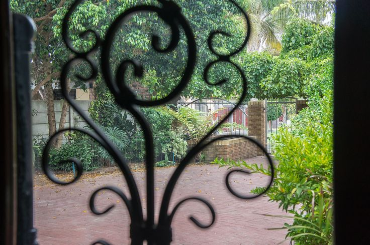 A peak through the front door with metal detail for decoration at this Paarl property.
