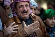 Syria: A relative of Abdulaziz Abu Ahmed Khrer, who was killed by a Syrian sniper, cried during the funeral on Thursday. Photo by Rodrigo Abd, Associated Press