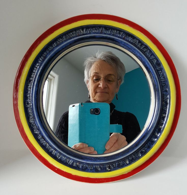 Got an empty space on one of your walls that needs cheering up? This Handmade Pottery Frame with the Mirror and a sturdy hook on the back should do the trick.