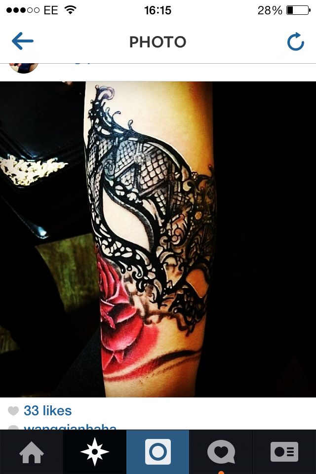 Lace mask tattoo