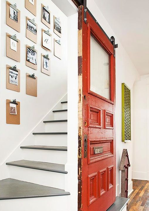 clever way to hang photos - clipboards. not to mention i love the red door!