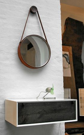 This wall mounted table is a great idea for storing keys, etc. in a small space.
