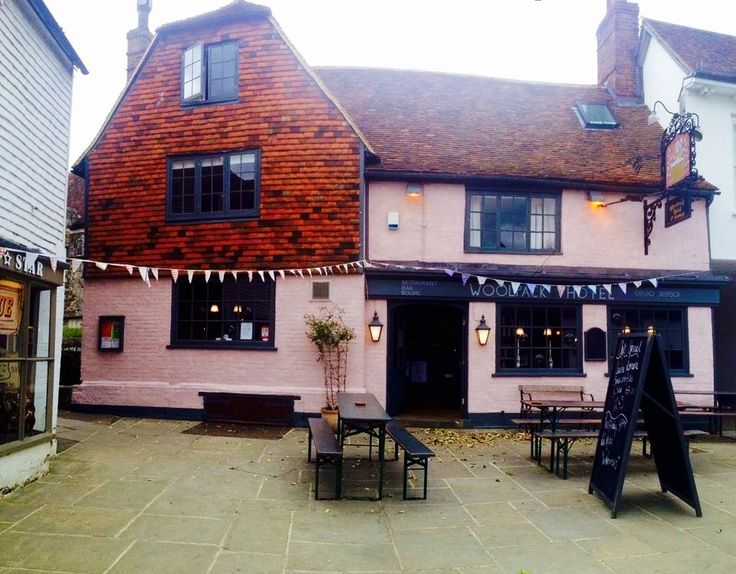 Woolpack Pub, pale pink with vertical hanging tiles - Tenterden, England