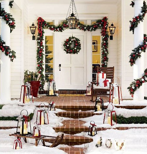 Front porch decor for Christmas . . . this is why I love colonial style houses - they make the best Christmas entrances!