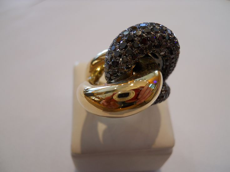 """""""Hold me tonight"""" ring. two colours of 18k gold, black diamonds."""