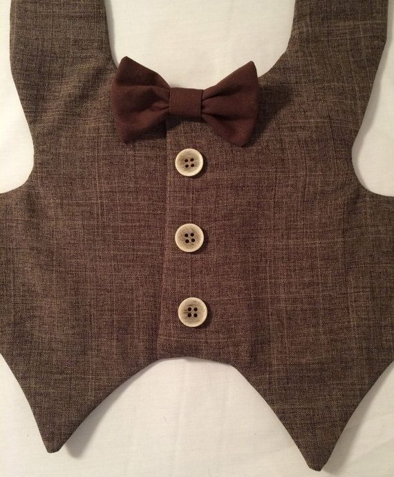 Custom made brown tweed look dog vest has light colored buttons down the dogs…
